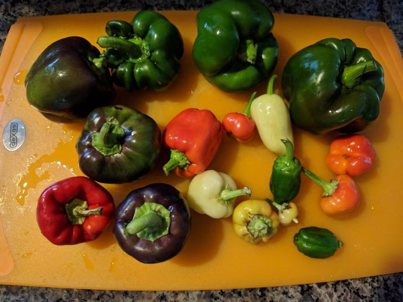 colorful peppers on a cutting board